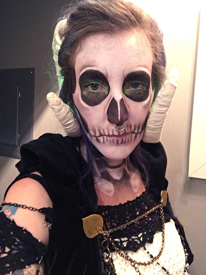 lich halloween makeup, stephanie has on skull makeup with green accents