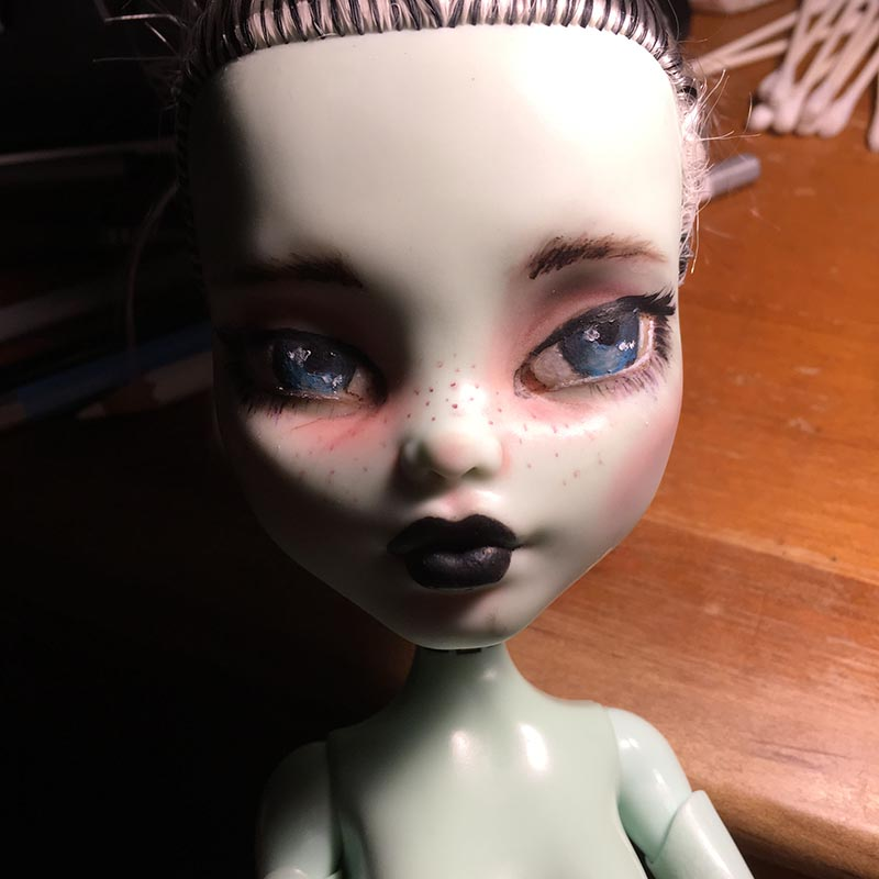 a monster high doll with a repainted face that looks more realistic than the original cartoony painting.