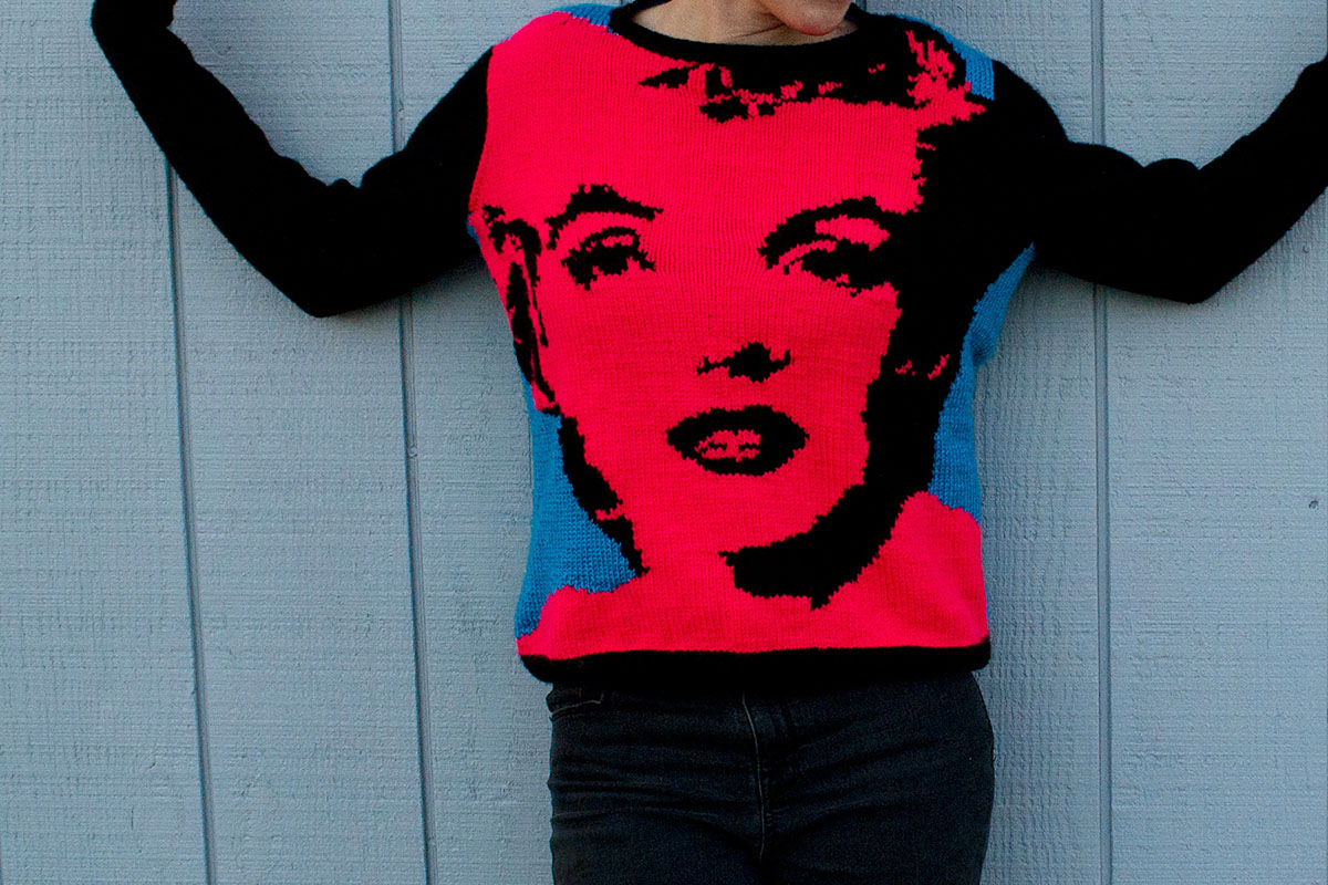 a boxy sweater with andy warhol inspired marilyn monroe pop art in neon pink and blue