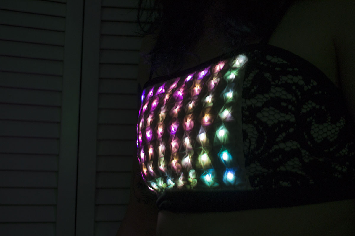 a matrix of rainbow leds under textured fabric