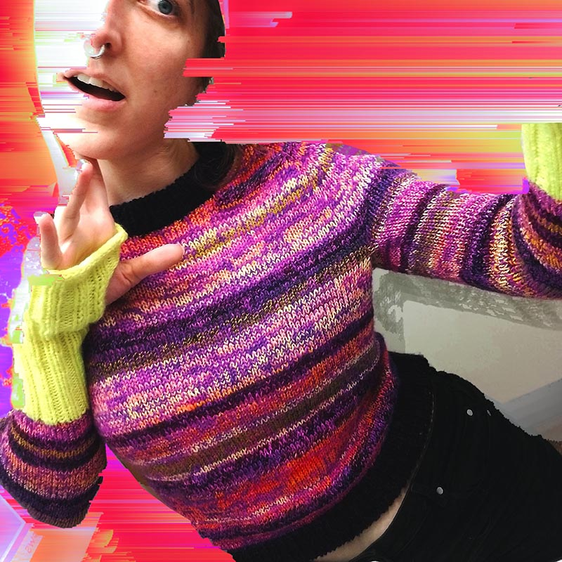 a brightly striped purple, neon yellow, and orange sweater