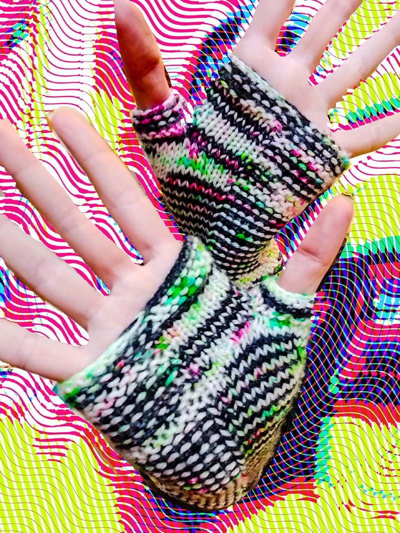 black and white striped arm warmers with neon green and pink speckles
